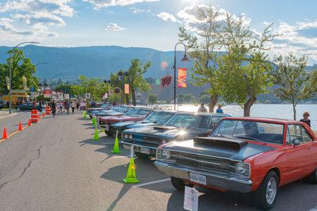 Penticton, British ColumbiaCanada - June 21, 2019: rows of vintage cars line Lakeshore Drive for the Peach City Beach Cruise, a popular annual car show.