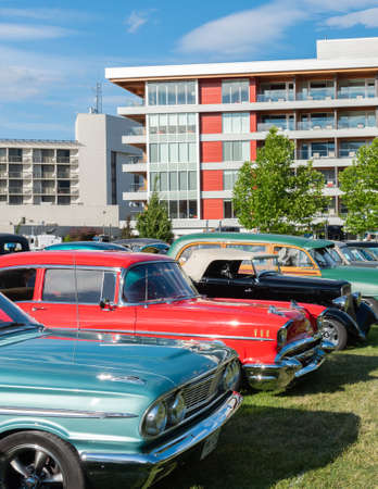 Penticton, British ColumbiaCanada - June 22, 2019: vintage cars parked beside the Penticton Lakeside Resort during the Peach City Beach Cruise, a famous annual car show