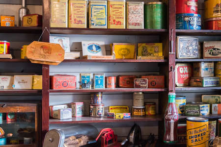 Vernon, British ColumbiaCanada - October 23, 2016: tins of vintage dry goods displayed on shelves in the general store at OKeefe Ranch, a popular tourist attraction