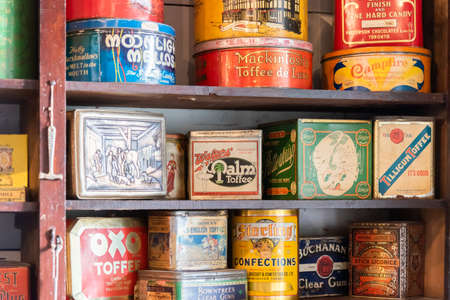 Vernon, British ColumbiaCanada - October 23, 2016: close-up of tins of vintage dry goods on shelves in the general store at OKeefe Ranch, a popular tourist attraction