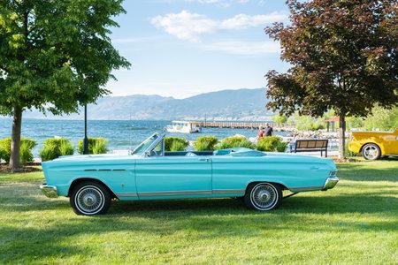 Penticton, British ColumbiaCanada - June 21, 2019: vintage convertible car parked by Okanagan Lake during the Peach City Beach Cruise, a popular annual car show