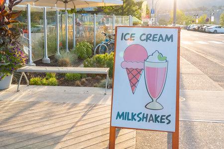 Penticton, British ColumbiaCanada - August 29, 2019: sign advertising ice cream and milkshakes by Patio Burger, a popular summer restaurant on Lakeshore Drive.