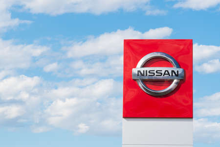 Penticton, British ColumbiaCanada - September 1, 2019: close-up of Nissan logo on sign outside car dealership with sky in background