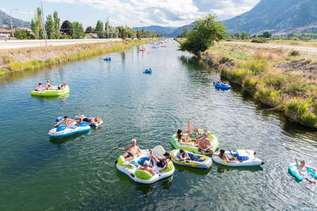 Penticton, British Columbia/Canada - September 1, 2019: view of people floating down the Penticton River Channel, a popular summer activity.