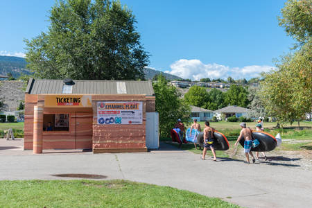 Penticton, British ColumbiaCanada - September 2, 2019: people with inner tubes at Coyote Cruises ticket building, a a popular rental and shuttle service for tubing down the Penticton River Channel.
