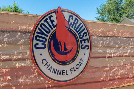 Penticton, British ColumbiaCanada - September 2, 2019: close-up of sign on building at Coyote Cruises Channel Float, a tube rental and shuttle service for the Penticton River Channel