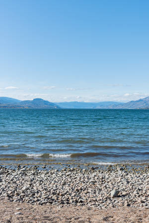 View of Three Mile Beach on Okanagan Lake in Penticton, BC, Canada on sunny afternoon