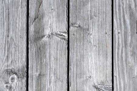 Close-up of planks of grey weathered wood background 版權商用圖片