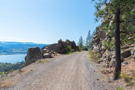Kettle Valley Rail Trail high up on mountain side above Okanagan Lake and Okanagan Valley 版權商用圖片