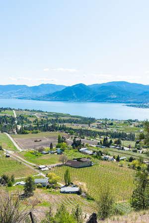 View above Naramata of Okanagan Valley, Okanagan Lake, and mountains in springtime