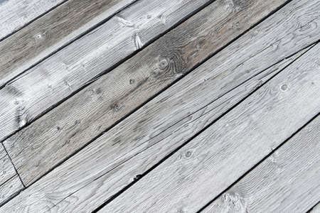 Rustic gray wooden planks in diagonal rows. Full-frame background with copy space. 版權商用圖片