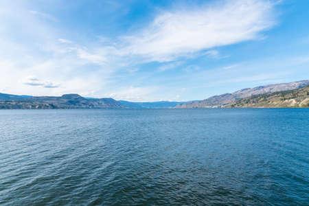 View from Naramata Wharf Park of Okanagan Lake, blue sky, and distant  mountains in Okanagan Valley