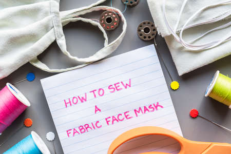 How to sew a fabric face mask, flat lay arrangment of face mask and sewing equipment for making mask 版權商用圖片