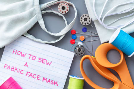 Flat-lay arrangement of supplies needed to sew a fabric face mask