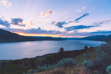 Panoramic sunset summer view of Okanagan Lake from Munson Mountain