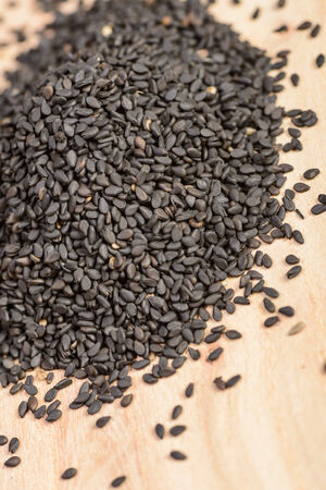 sesame seeds: black sesame seeds on the wooden board Stock Photo