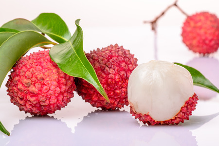 fresh lychee and leaves on the white background photo