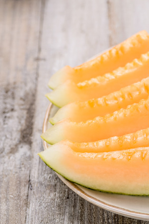melon pieces on the wooden board photo