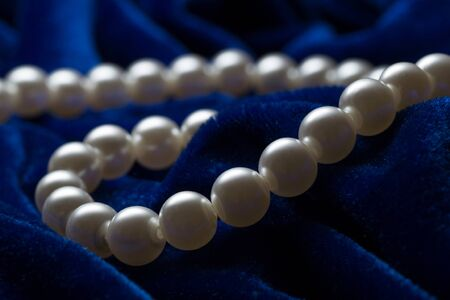 string of pearls: string of pearls on the blue background.