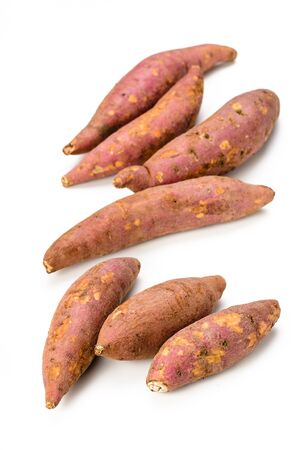 red sweet potatoes on the white background. photo