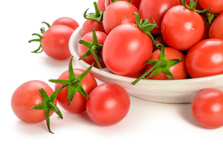 fresh red cherry tomatoes isolated on white background photo