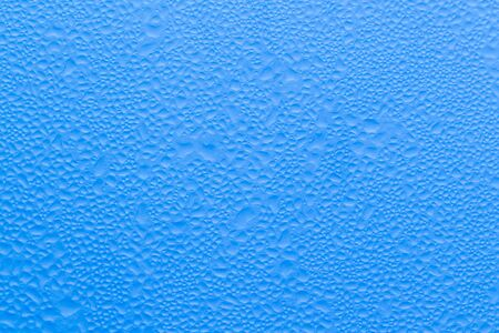 wetness: blue background of water drops.