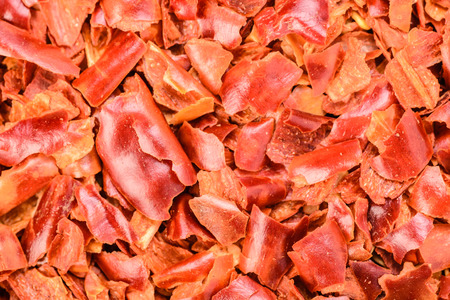 crushed red peppers: foo background of red chilli flakes