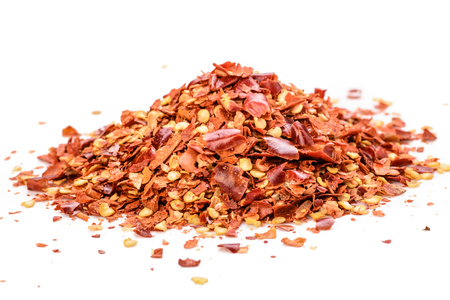 crushed red peppers: red chili flakes on the white background