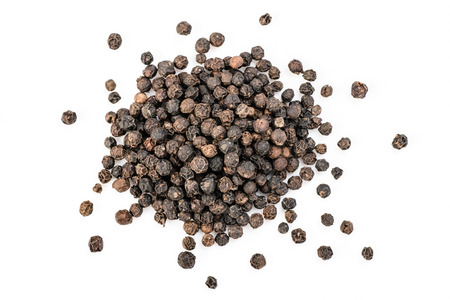 black peppers on the white background photo
