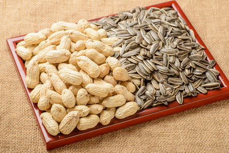 goober: peanuts and sunflower seeds in the wooden plate