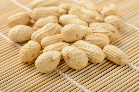 bamboo mat: peanuts on the bamboo mat Stock Photo