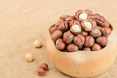 cobnut: dried hazelnut in the wooden bowl Stock Photo