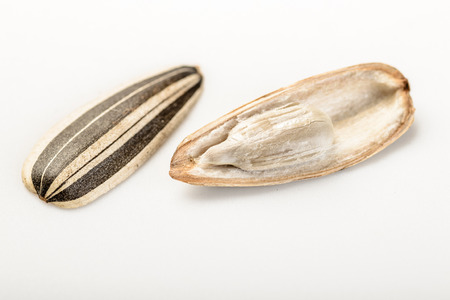 sunflower seeds: baked sunflower seeds on the white background