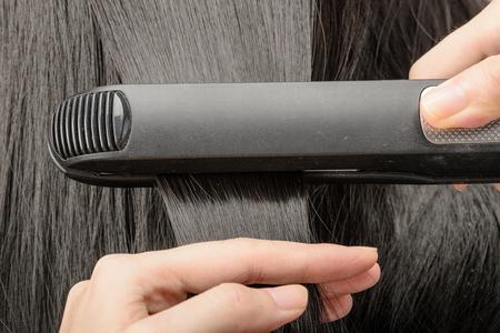 straighten: straighten hair Stock Photo