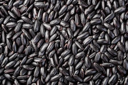 food background of black rice Stock Photo