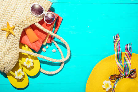 beach accessories on the blue wooden board