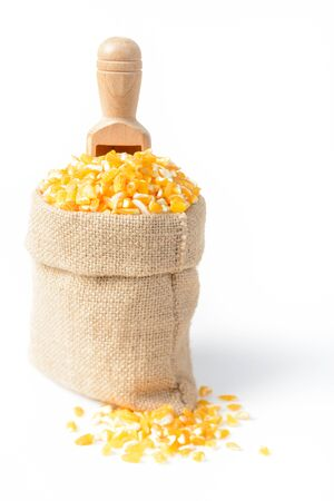 grits: yellow corn grits on white  Stock Photo