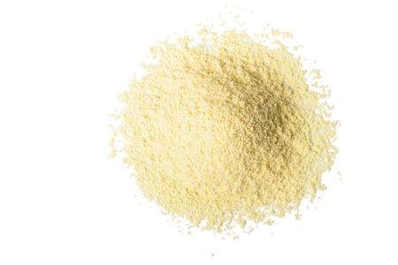 yellow flour: yellow corn flour on white, tilt shift lens Stock Photo
