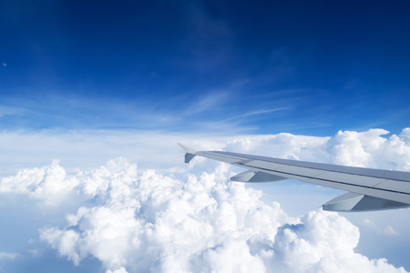 wingtips: airplane wing on the clouds sea