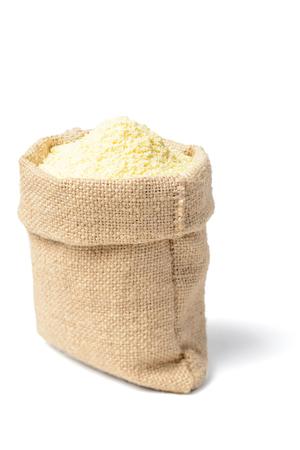 raw corn flour on white, tilt shift lens Stock Photo