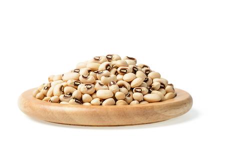 tilt and shift: raw black eyed peas in the wooden plate, (large depth of field, taken with tilt shift lens)