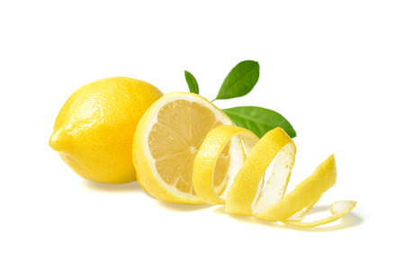 citruses: fresh lemon and lemon peel on white