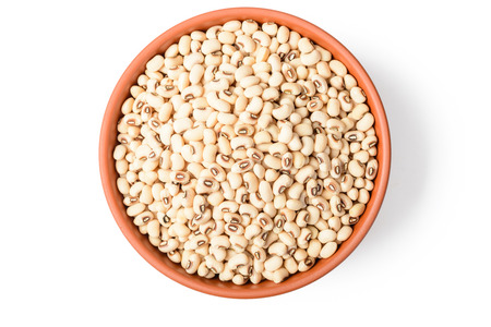 cow pea: uncooked white cow pea beans in the bowl. top view