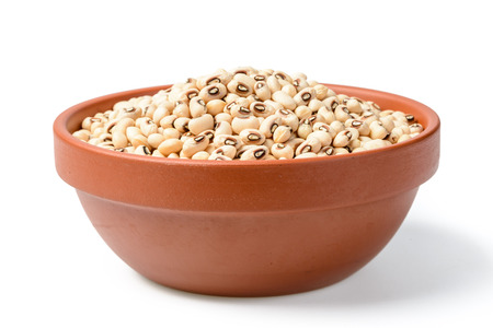 cow pea: uncooked white cow pea beans in the bowl. (large depth of field, taken with tilt shift lens) Stock Photo