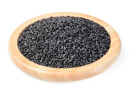 black sesame: black sesame in the wooden plate Stock Photo