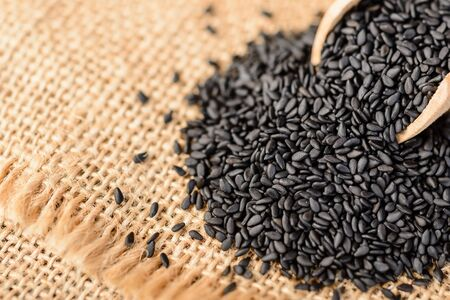 raw food: black sesame on the linen tablecloth