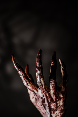 bloody hand in the dark