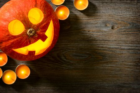 halloween lantern: jack o lantern, pumpkin lantern on the wooden board