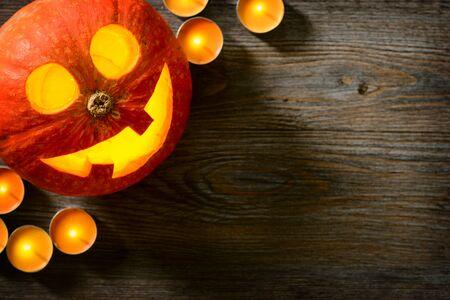jack o lantern, pumpkin lantern on the wooden board