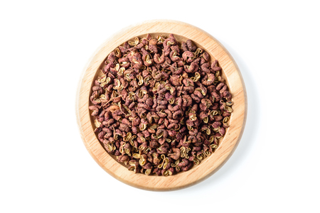 dry food: dry pink pepper in the wooden plate
